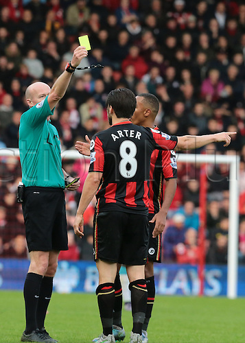 07.11.2015. Vitality Stadium, Bournemouth, England. Barclays Premier League. Harry Arter of Bournemouth receives a yellow card off Referee Lee Mason for rough challenge on Papiss Cisse of Newcastle