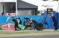 Aug 31, 2018; Clermont, IN, USA; Crew members for NHRA top fuel driver Leah Pritchett during qualifying for the US Nationals at Lucas Oil Raceway. Mandatory Credit: Mark J. Rebilas-USA TODAY Sports