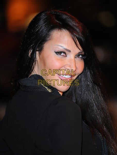 LIZZIE CUNDY.At the UK Premiere of 'Where The Wild Things Are' at the Vue West End, Leicester Square, London, England, UK, December 2nd 2009..portrait headshot looking over shoulder profile make-up black .CAP/BEL.©Tom Belcher/Capital Pictures.