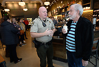 Sgt. Brad Cavender (center) with the Washington County Sheriff's Office speaks Thursday, Feb. 13, 2020, with Tim Kral of Fayetteville during Coffee With a Cop at Starbucks on Wedington Drive in Fayetteville. Several members of the Fayetteville Police Department and the Washington County Sheriff's Office met with the public for coffee and conversation.Visit nwaonline.com/200214Daily/ for today's photo gallery.<br /> (NWA Democrat-Gazette/Andy Shupe)