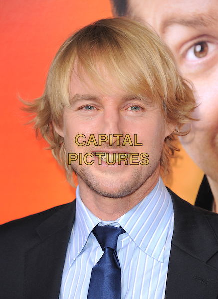 """OWEN WILSON .At the Warner Bros. Pictures' Premiere of """"Hall Pass"""" held at The Cinerama Dome, Hollywood, California, USA, .23rd February 2011..portrait headshot blue shirt tie beard facial  hair stubble smiling .CAP/RKE/DVS.©DVS/RockinExposures/Capital Pictures."""