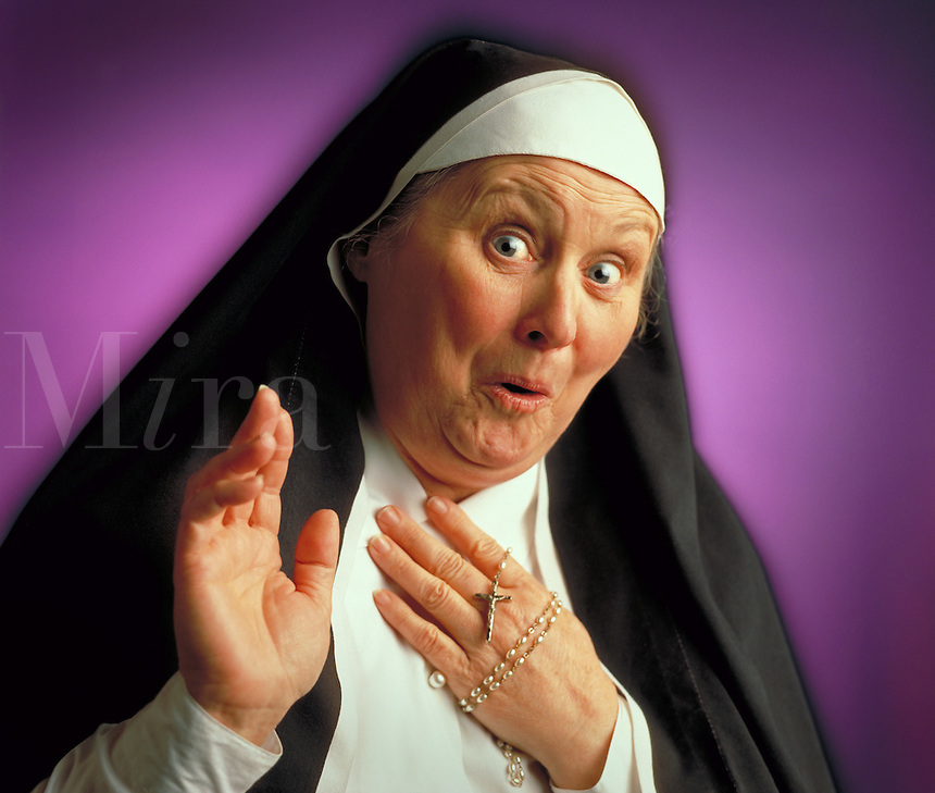 Nun with surprised expression. Billboard and broadcast must be negotiated, due to talent agreement. Nun. United States.