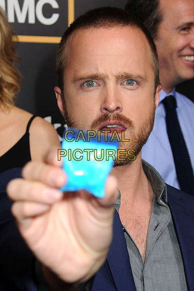 "Aaron Paul.AMC's ""Breaking Bad"" Season 5 Premiere at Comic-Con 2012 held at Reading Cinemas, San Diego, California, USA..July 14th, 2012.headshot portrait blue jacket grey gray shirt beard facial hair zip lock bag baggie powder crystal meth drugs mouth open.CAP/ADM/BP.©Byron Purvis/AdMedia/Capital Pictures."