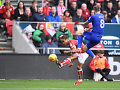 4th November 2017, Ashton Gate, Bristol, England; EFL Championship football, Bristol City versus Cardiff City; Joe Ralls of Cardiff City tries to block the cross from Bobby Reid of Bristol City