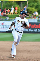Josh Hamilton (33) of the Salt Lake Bees during the game against the Albuquerque Isotopes at Smith's Ballpark on May 22, 2014 in Salt Lake City, Utah.  The 2010 American League MVP from the Los Angeles Angels of Anaheim joined the Bees for a rehab stint. (Stephen Smith/Four Seam Images)