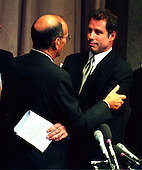 United States Senator Alfonso D'Amato (Republican of New York) hugs actor John Travolta after the former's testimony before the Commission on Security and Cooperation in Europe, Regarding Discrimination Against Religious Minorities in Germany in Washington, D.C. on September 18, 1997.  Travolta is a member of the Church of Scientology.  Members of the Church have been subject to religious persecution in Germany..Credit: Ron Sachs / CNP
