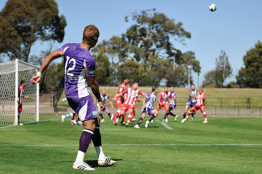 MELBOURNE - 22 September: Ryo NAGAI of the Glory takes a free kick at a pre-season match between Melbourne Heart and Perth Glory at Epping Stadium on 22 September 2012. (Photo by Sydney Low / syd-low.com)