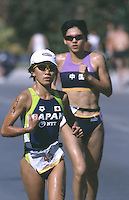 10 NOV 2002 - CANCUN, MEXICO - Maki Shimomura (JPN) and Meng Shi - World Elite Womens Triathlon Championships. (PHOTO (C) NIGEL FARROW)