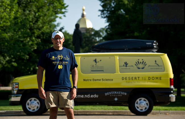 University of Notre Dame College of Science dean Greg Crawford poses with a support van that will follow Dean Crawford and his wife Renate as they bike from Tucson, AZ to Notre Dame in July and August of 2010 to raise awareness of Notre Dame's new partnership with the Ara Parseghian Medical Research Foundation...Photo by Matt Cashore/University of Notre Dame