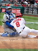 New York Mets catcher Travis d'Arnaud (18) tags out Washington Nationals center fielder Brian Goodwin (8) as he tries to score in the second inning at Nationals Park in Washington, D.C. on Saturday April 7, 2018.<br /> Credit: Ron Sachs / CNP<br /> (RESTRICTION: NO New York or New Jersey Newspapers or newspapers within a 75 mile radius of New York City)