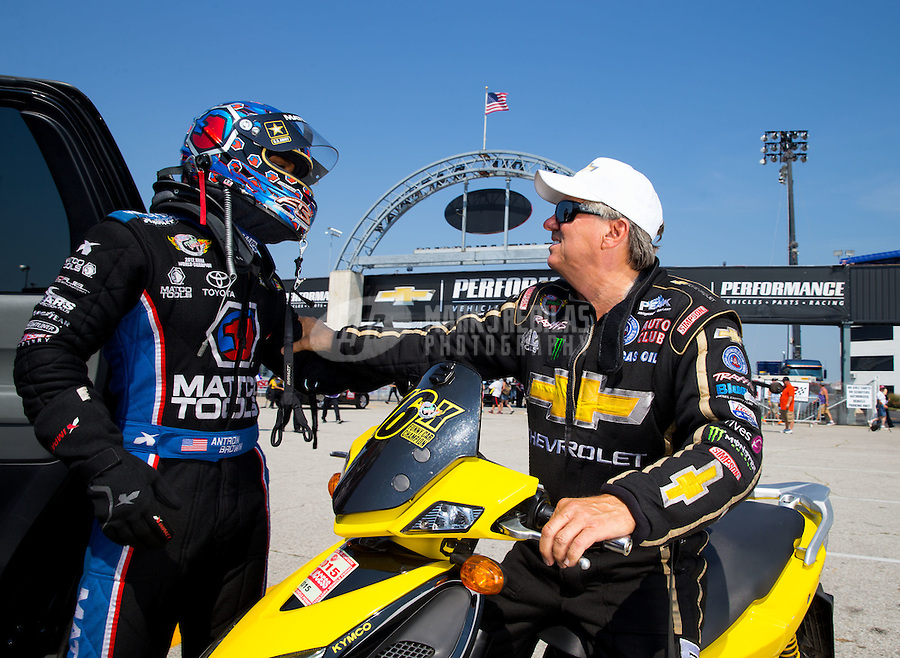 Sep 6, 2015; Clermont, IN, USA; NHRA funny car driver John Force (right) talks to top fuel driver Antron Brown during qualifying for the US Nationals at Lucas Oil Raceway. Mandatory Credit: Mark J. Rebilas-USA TODAY Sports