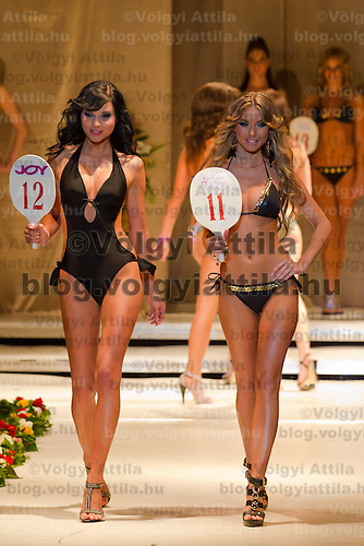 Aniko Nadas (left) and Ivett Venczlik (right) attends the Miss Hungary 2010 beauty contest held in Budapest, Hungary on November 29, 2010. ATTILA VOLGYI