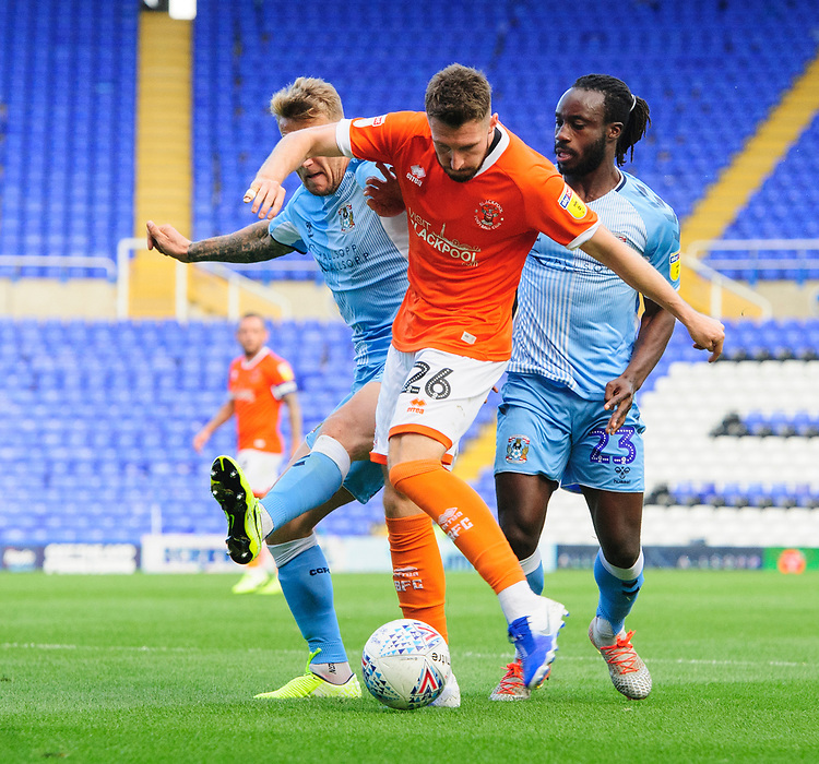Blackpool's James Husband has a shot at goal under pressure from Coventry City's Kyle McFadzean<br /> <br /> Photographer Chris Vaughan/CameraSport<br /> <br /> The EFL Sky Bet League One - Coventry City v Blackpool - Saturday 7th September 2019 - St Andrew's - Birmingham<br /> <br /> World Copyright © 2019 CameraSport. All rights reserved. 43 Linden Ave. Countesthorpe. Leicester. England. LE8 5PG - Tel: +44 (0) 116 277 4147 - admin@camerasport.com - www.camerasport.com
