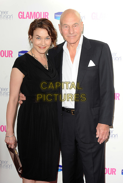 GUEST & PATRICK STEWART .The 2010 Glamour Women Of The Year Awards - inside arrivals, Berkeley Square Gardens, London, England, UK,.8th June 2010..half length suit dress black white shirt .CAP/BEL.©Tom Belcher/Capital Pictures.