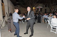 Trevor Moawad '95<br /> Coach Brian Newhall '83<br /> Now in his 30th year as Oxy's head men's basketball coach, Brian Newhall received a much deserved celebration with a surprise halftime ceremony and post game reception in the Booth Hall courtyard with more than 70 former and current players from all different generations and decades in attendance, on Saturday, Jan. 26, 2019.<br /> Newhall is the winningest coach in Oxy history and has a 100 percent graduation rate in his 30 years at the helm of the program. His resume boasts multiple SCIAC Championships and NCAA Playoff appearances, along with a run to the NCAA Division III Elite Eight in 2003 and the only perfect 14-0 season in SCIAC history. Newhall has not only coached at Oxy, but was a SCIAC Champion and SCIAC Player of the Year during his playing career at Oxy in the early 80s.<br /> (Photo by Marc Campos, Occidental College Photographer)