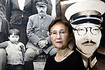 "Yuko Tojo, granddaughter of Japan's wartime leader, General Hideki Tojo, poses in front of a portion of an enlarged family photo taken with her grandfather when she was 2 at her home in Tokyo on  23 July 2005. Gen. Hideki Tojo - who ordered the attack on Pearl Harbor -- was charged and hanged as a war criminal after World War II when Yuko was just 6. Though she remembers little of her grandfather she still regards him as a hero. ""Japan did not fight a war of aggression but in self-defense,"" says Ms. Tojo, widely seen as a leading figurehead in a recent surge in nationalism in Japan and who unsuccessfully ran for a seat in Japan's House of Councilors in 2007. ""Schoolchildren are told what evil things our country and their ancestors did during the war and this has led to a lack of pride in the Japanese people. This is wrong. We must reinstall a sense of pride and confidence in our children."" Upon running for a seat in Japan's Upper House of Parliament, one of her main goals was to ensure all of Japan's war dead would be enshrined at Yasukuni Shrine, where her grandfather and 13 other convicted war criminals are currently enshrined."