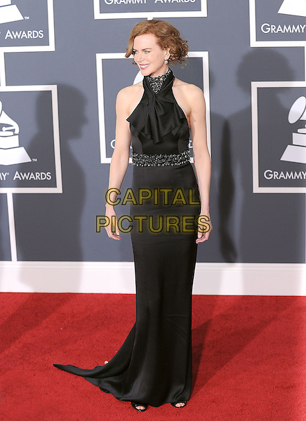NICOLE KIDMAN .Arrivals at the 52nd Annual GRAMMY Awards held at The Staples Center in Los Angeles, California, USA..January 31st, 2010.grammys full length black maxi dress sleeveless halterneck high collar beads beaded waist.CAP/RKE/DVS.©DVS/RockinExposures/Capital Pictures