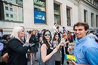 Workers try out their Snap Spectacles outside the New York Stock Exchange during the Blue Apron IPO on Thursday, June 29, 2017.  (© Richard B. Levine)
