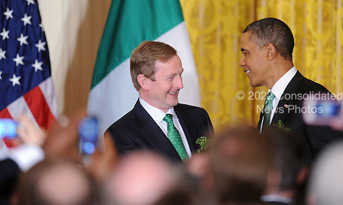 U.S. President Barack Obama jokes with Prime Minister Enda Kenny of Ireland during a reception in the East Room of the White House in Washington, D.C., March 19, 2013 in Washington, DC. <br /> Credit: Olivier Douliery / Pool via CNP