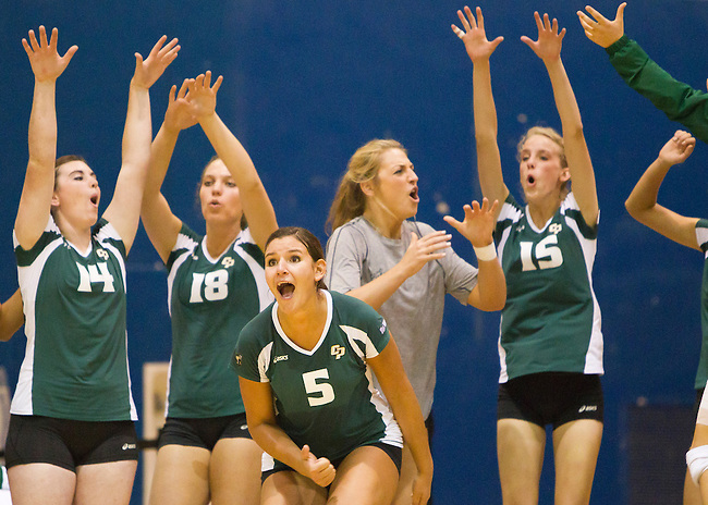 Cal Poly San Luis Obispo teammates celebrate a critical point at Cal State Fullerton womens volleyball, Sep. 23, 2011.