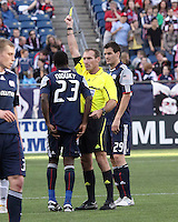 New England Revolution midfielder Joseph Niouky (23) is given a yellow card for a foul in the first half by the referee, Terry Vaughn.  The New England Revolution and San Jose Earthquakes play to a scoreless draw at Gillette Stadium on May 15, 2010