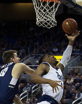 Nevada forward Tre'Shawn Thurman (0) puts up a shot against Utah State in the first half of an NCAA college basketball game in Reno, Nev., Wednesday, Jan. 2, 2019. (AP Photo/Tom R. Smedes)