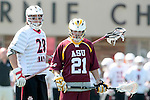 Orange, CA 05/02/10 - Andrew Salcido (Chapman # 28) and Kris Saunders (ASU # 21) in action during the Chapman-Arizona State MCLA SLC Division I final at Wilson Field on Chapman University's campus.  Arizona State defeated Chapman 13-12 in overtime.