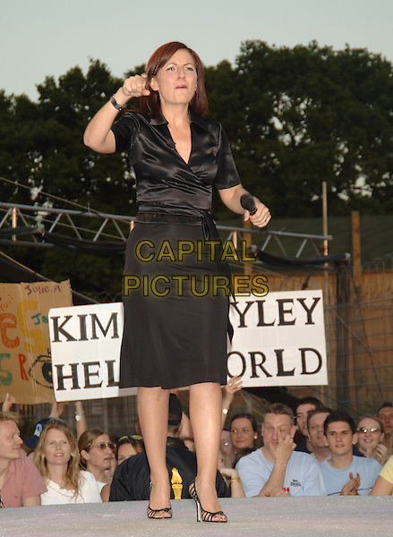 "DAVINA McCALL.""Big Brother 6"" House re-opens,.Elstree Studios, Hertfordshire,.27th May 2005..full length funny black satin wrap shirt skirt dress pointing.Ref: PL.www.capitalpictures.com.sales@capitalpictures.com.©Capital Pictures"