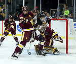 SIOUX FALLS, SD - MARCH 23: Jared Thomas #22 from Minnesota Duluth battles for the loose puck with Brad Mcclure #19 from Mankato during their game at the 2018 West Region Men's NCAA DI Hockey Tournament at the Denny Sanford Premier Center in Sioux Falls, SD. (Photo by Dave Eggen/Inertia)