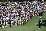 AUGUSTA, GA - APRIL 10:  Tiger Woods walks down the fairway as fans watch during the 2010 Masters Tournament held in Augusta, Georgia at Augusta National Golf Club on April 10, 2010. (Photo by Donald Miralle)..
