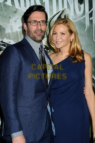 "JON HAMM & JENNIFER WESTFELDT.""Sucker Punch"" Los Angeles Premiere held at Grauman's Chinese Theatre, Hollywood, California, USA..March 23rd, 2011.half length glasses blue shirt suit tie checked gingham one shoulder dress couple gold stubble facial hair.CAP/ADM/BP.©Byron Purvis/AdMedia/Capital Pictures."