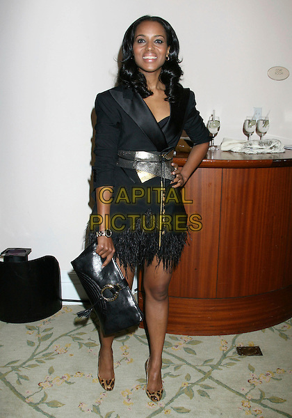 KERRY WASHINGTON.2nd Annual ESSENCE Black Women In Hollywood Luncheon held at the Beverly Hills Hotel, Beverly Hills, California, USA..February 19th, 2009.full length black dress clutch bag gold waist feather trim leopard print shoes hand on hip.CAP/ADM/MJ.©Michael Jade/AdMedia/Capital Pictures.