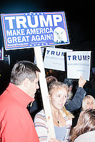 Supporters of Donald Trump gather near the Sheraton Portsmouth Harborside Hotel in Portsmouth, New Hampshire, USA. At the hotel later that evening, Republican presidential candidate and real estate mogul Donald Trump received an endorsement from the New England Police Benevolent Association executive council. A small group of perhaps 20 Trump supporters stood outside the hotel and there was a larger group of anti-Trump protesters, mostly across the street. One of the protest organizers estimated that there were around 230 protesters gathered.Many protesters expressed disagreement with Trump's recent statements that he would ban all Muslims from entering the country. Trump brought up the recent shooting in San Berdardino, Calif., at the meeting.
