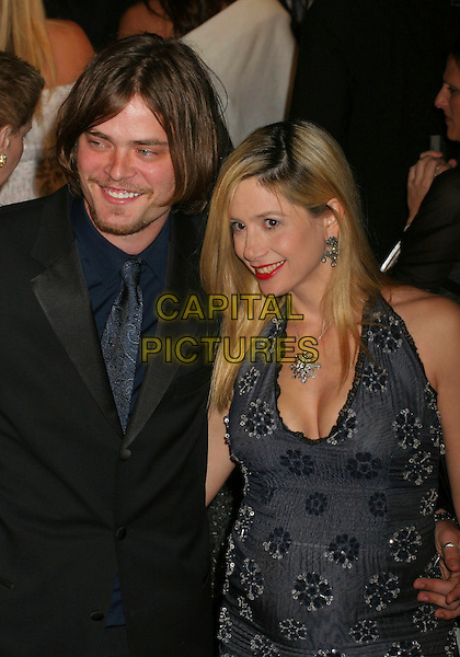CHRIS BACKUS & MIRA SORVINO.2006 Vanity Fair Oscar Party held at Morton's, West Hollywood, California, USA, 05 March 2006..oscars half length necklace black halterneck dress  married husband wife.Ref: ADM/RE.www.capitalpictures.com.sales@capitalpictures.com.©Russ Elliot/AdMedia/Capital Pictures.