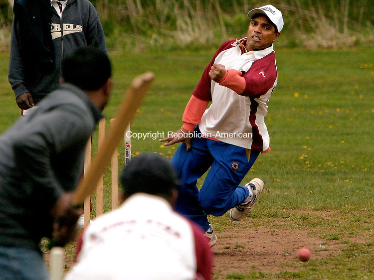 WATERBURY, CT- 08 MAY 2005-050805JS01--Rising Star bowler Rishi Persaud bowls the ball to the batsman during their match against Park Lane of Queens, NY Sunday at Washington Park in Waterbury. The cricket teams are part of the West Indian Softabll Association. --- Jim Shannon Photo--Rishi Persaud; Rising Star; Park Lane; Washington Park are CQ