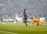 Nederland, Amsterdam, 20 januari 2013.Eredivisie.Seizoen 2012-2013.Ajax-Feyenoord.Viktor Fischer (l.) van Ajax scoort de 1-0. Rechts Joris Mathijsen en Erwin Mulder, keeper (doelman) van Feyenoord.