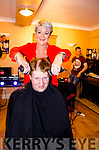 OUT OF THE WILD WEST:  Local Kilgarvan hairdresser Clare Randles handles her shavers like a pair of six guns as she takes to the head of Richard Rice during a head shaving and waxing charity event held in Healy Rae's Bar in aid of the Kerry/Cork Cancer Link Bus.
