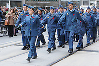 Royal Canadian Air Cadet Paiva leads squad mates marching along Queen Street West in front of Old City Hall during the Rememberance Day ceremony in Toronto, Ontario, Canada, November 11, 2011.