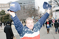 A man wearing an American flag shirt celebrates the inauguration of President Donald Trump on Jan. 20, 2017, in Washington, D.C.