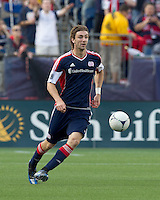 New England Revolution midfielder Stephen McCarthy (26) brings the ball forward. In a Major League Soccer (MLS) match, DC United defeated the New England Revolution, 2-1, at Gillette Stadium on April 14, 2012.