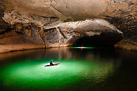 Cavers kayak through a passage in Xe Bang Fai River Cave (Tham Khoun Xe).