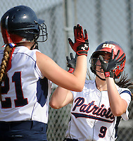 Central Bucks East's Nicole Tracy #21 and Guiliana Ruscio #9 celebrate a run in the third inning against Downingtown West Wednesday May 25, 2016 at Central Bucks East in Buckingham, Pennsylvania. (Photo by William Thomas Cain)