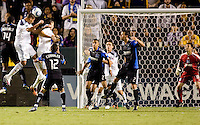 LA Galaxy defender Omar Gonzalez (4) attempts to head a ball home. The LA Galaxy and the San Jose Earthquakes played to a 2-2 draw at Home Depot Center stadium in Carson, California on Thursday July 22, 2010.