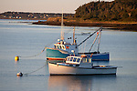 Late afternoon light on two fishing Boats in Lubec Harbor, Maine