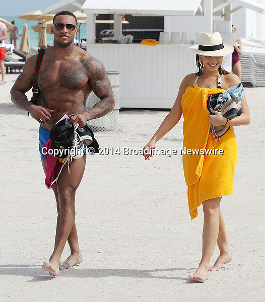 Pictured: Kelly Brook, David Mcintosh<br /> Mandatory Credit &copy; JOMI/Broadimage<br /> Kelly Brook and her boyfriend David Mcintosh from The Gladiators taking a bike ride around Miami Beach and then a swim in the ocean<br /> <br /> 2/3/14, Miami , Florida, United States of America<br /> <br /> Broadimage Newswire<br /> Los Angeles 1+  (310) 301-1027<br /> New York      1+  (646) 827-9134<br /> sales@broadimage.com<br /> http://www.broadimage.com