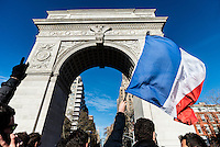 New York, NY - 14 November 2015 NYC  New Yorkers and French Nationals gathered beneath the Washington Square arch in a vigil to commemorate the victims of the 13 November Paris terror attacks.