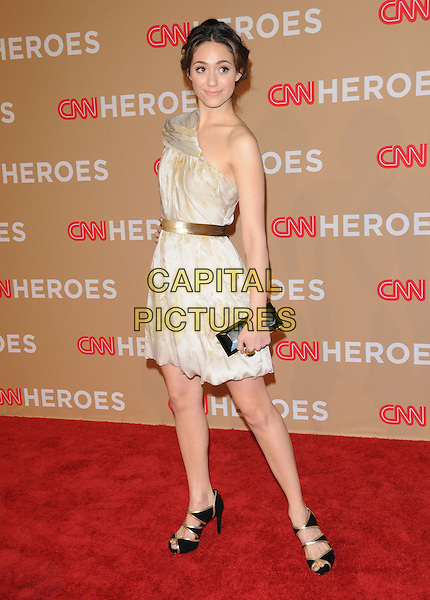 EMMY ROSSUM .at The CNN Heroes: An All-star Tribute held at The Shrine Auditorium in Los Angeles, California, USA, .November 20th, 2010..full length hand on hip cuff bracelet belt clutch bag hair up one shoulder beige    cream gold print black cut out shoes open toe .CAP/RKE/DVS.©DVS/RockinExposures/Capital Pictures.