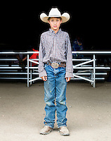 A young boy at the 4H competition at the Routt County Fair in Hayden, Colorado, Friday, August 14, 2015.<br /> <br /> Photo by Matt Nager