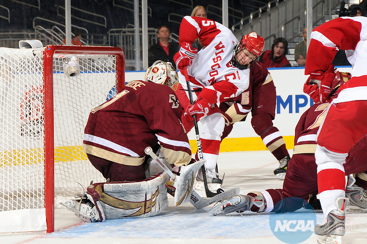10 APR 2010:  Wisconsin's Blake Geoffrion (5) and is stopped by goalie John Muse (1) of Boston College during the Division I Men's Ice Hockey Championship held at Ford Field in Detroit, MI. Boston College defeated Wisconsin 5-0 to win the national title game.  Mark Hicks/NCAA Photos