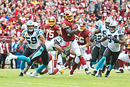Landover, MD - October 14, 2018: Washington Redskins running back Adrian Peterson (26) runs the ball during the  game between Carolina Panthers and Washington Redskins at FedEx Field in Landover, MD.   (Photo by Elliott Brown/Media Images International)